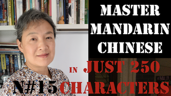 Chinese woman smiling in from of chinese bookshelf