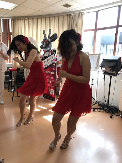Chinese ladies rehearsing salsa dance moves