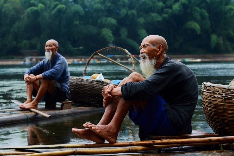 chinese fishermen on a boat