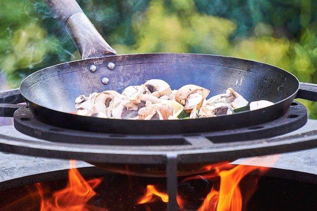Carbon steel wok under fire
