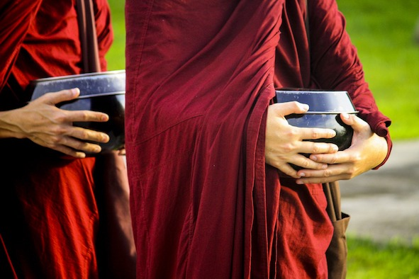 Buddhist Monks carrying soft tofu in a covered pot